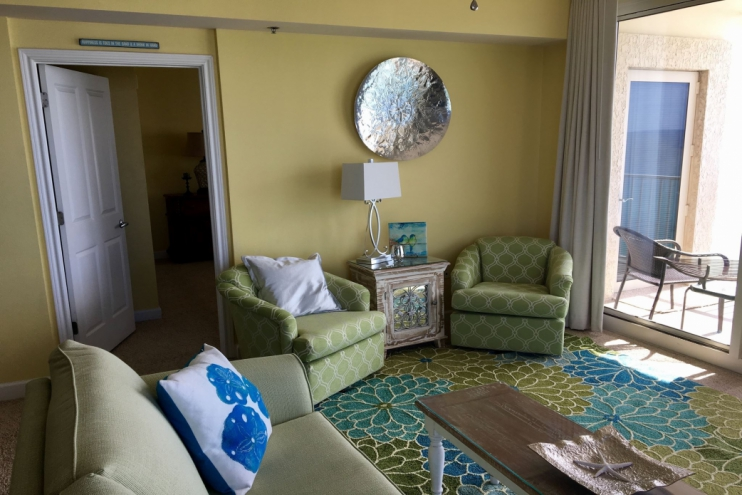Beautiful living room with new sleeper sofa & swivel chairs looking out to ocean