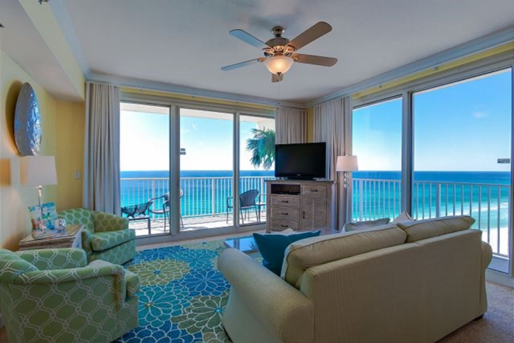 Dual sliding doors to access the wraparound balcony with ocean and sunset views