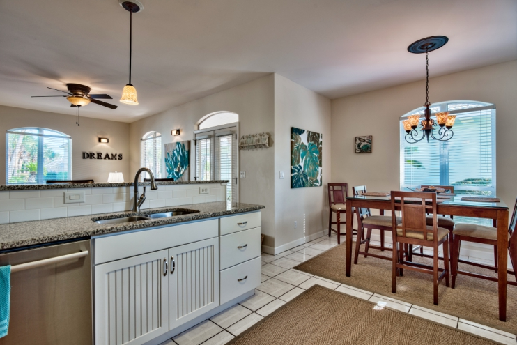Open concept living, kitchen and dining area including bar top counter with 3 leather stools for additional eating space!