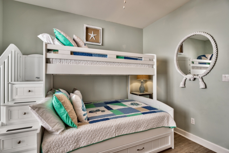 Bunkbeds with safety stairs leading to top bunk plus storage in the stair drawers!
