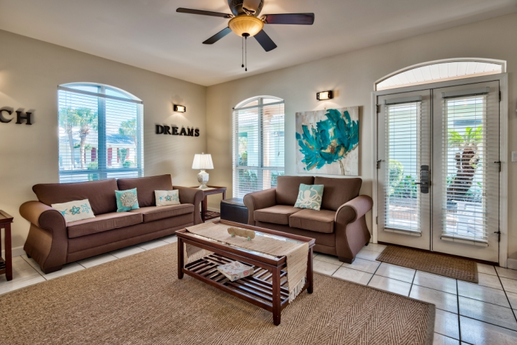 Bright, airy, coastal decorated living room with queen size sleeper sofa for extra guests!