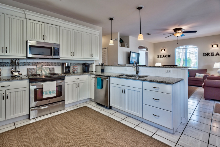 Kitchen with numerous small appliances, cookware and dishes for large families!