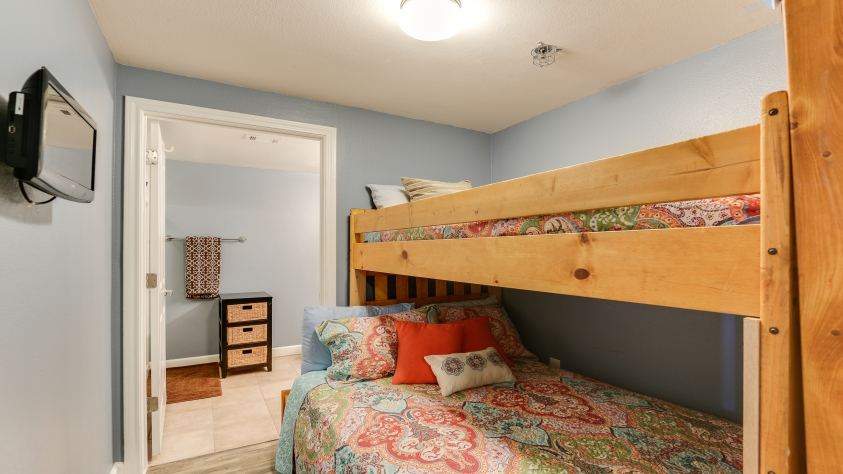 Bunkroom with DVD TV, Full over twin bed.  Leading to its own full bathroom