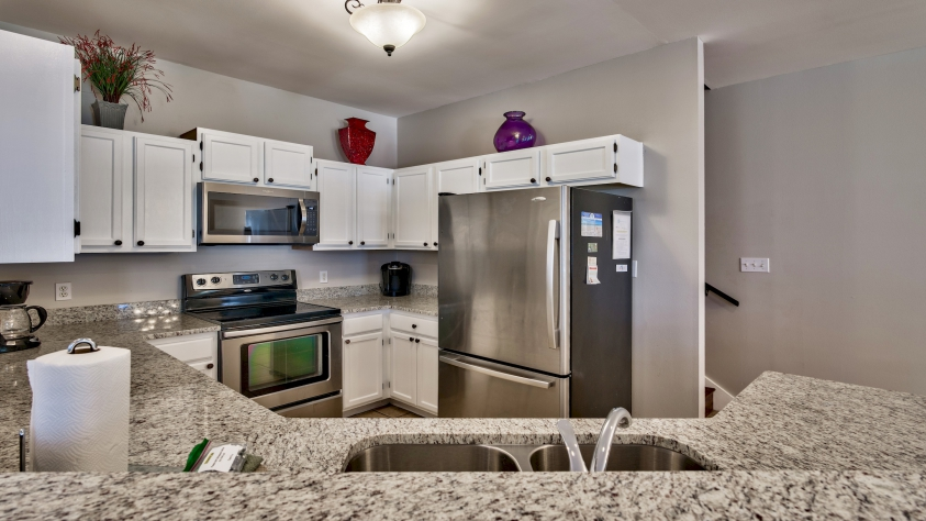 Updated Kitchen with Granite Counter-tops and Stainless Steel Appliances