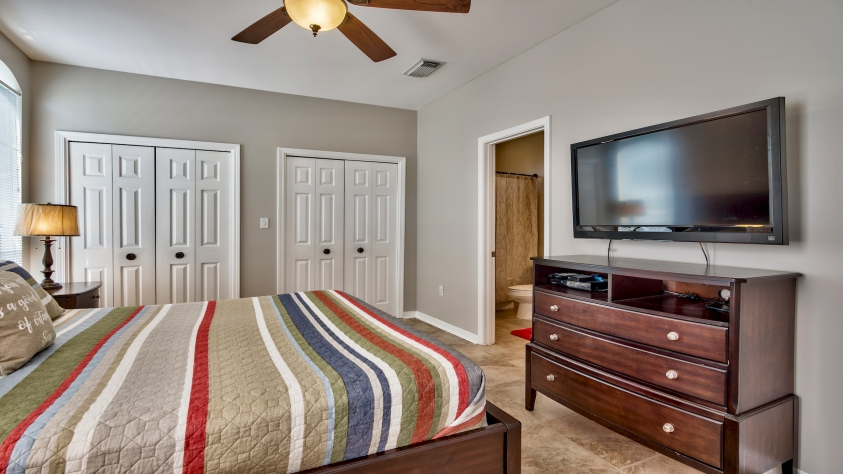 """First Floor Master Bedroom with King Bed and 42"""" Television"""