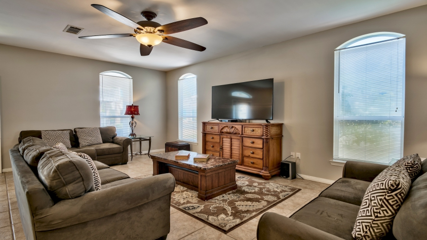 """Open Living - Dining - Kitchen Area with 65"""" television"""
